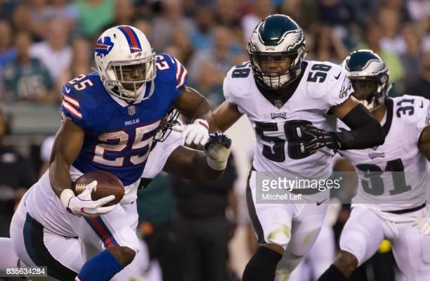 LeSean McCoy of the Buffalo Bills runs the ball against Jordan Hicks of the Philadelphia Eagles in the preseason game at Lincoln Financial Field on...