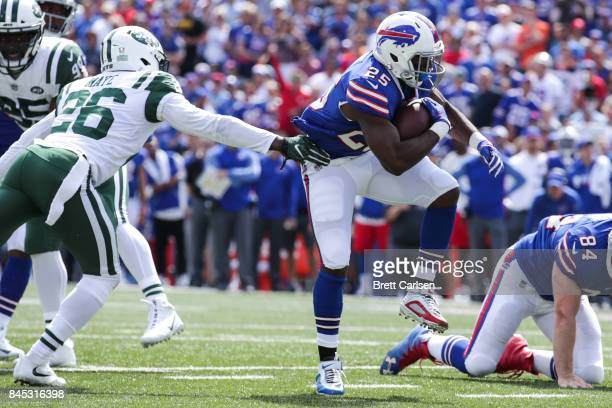 LeSean McCoy of the Buffalo Bills runs the ball as Marcus Maye of the New York Jets attempts to tackle him during the first quarter on September 10...
