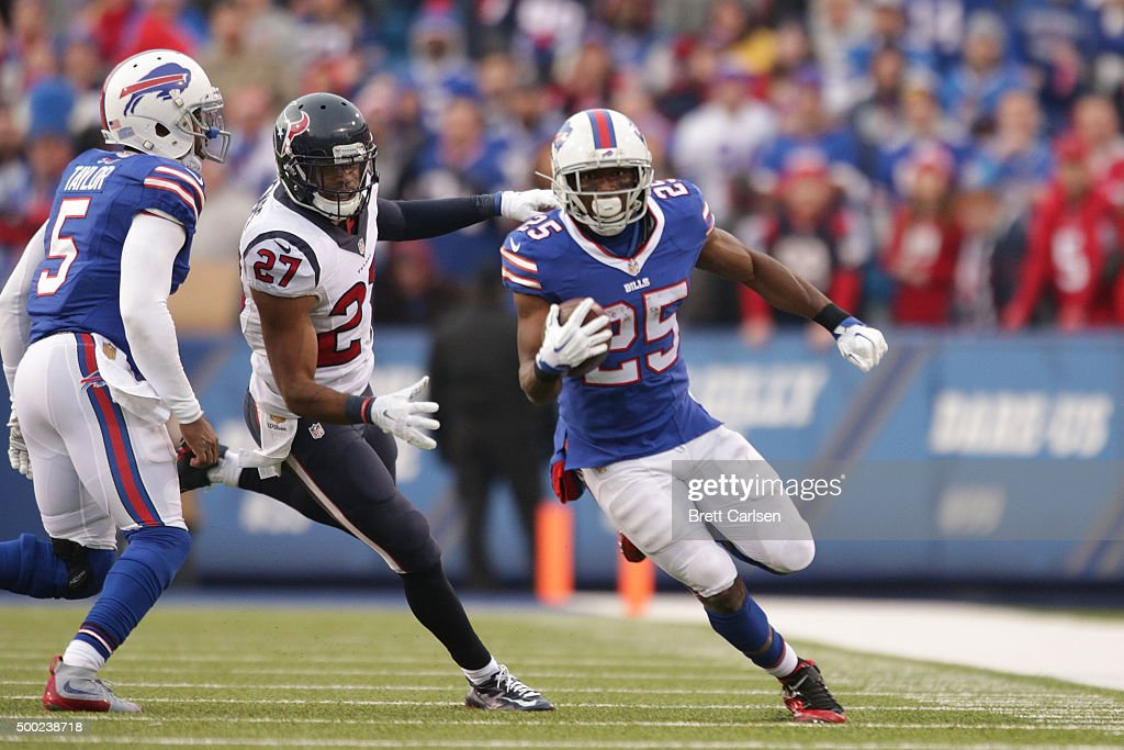 LeSean McCoy #25 of the Buffalo Bills runs the ball past Quintin Demps #27 of the Houston Texans during the second half at Ralph Wilson Stadium on December 6, 2015 in Orchard Park, New York.