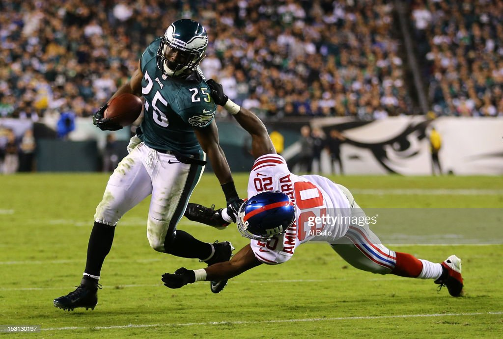 LeSean McCoy #25 of the Philadelphia Eagles applies a stiff arm to Prince Amukamara #20 of the New York Giants during their game at Lincoln Financial Field on September 30, 2012 in Philadelphia, Pennsylvania.