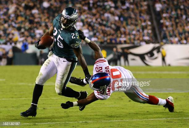 LeSean McCoy of the Philadelphia Eagles applies a stiff arm to Prince Amukamara of the New York Giants during their game at Lincoln Financial Field...