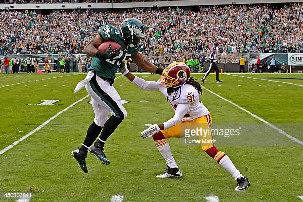 LeSean McCoy of the Philadelphia Eagles attempts to avoid the tackle of Brandon Meriweather of the Washington Redskins during a game on November 17...