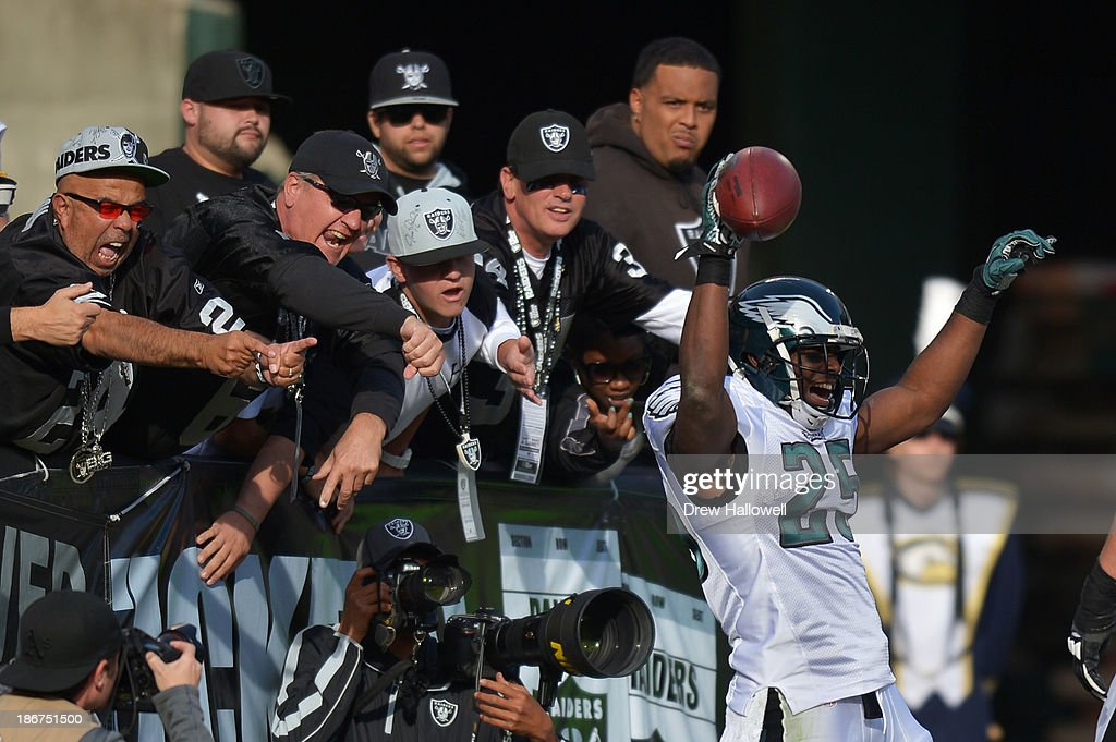 <a gi-track='captionPersonalityLinkClicked' href=/galleries/search?phrase=LeSean+McCoy&family=editorial&specificpeople=4484228 ng-click='$event.stopPropagation()'>LeSean McCoy</a> #25 of the Philadelphia Eagles celebrates a touchdown as Oakland Raiders fans react at O.co Coliseum on November 3, 2013 in Oakland, California. The Eagles won 49-20.