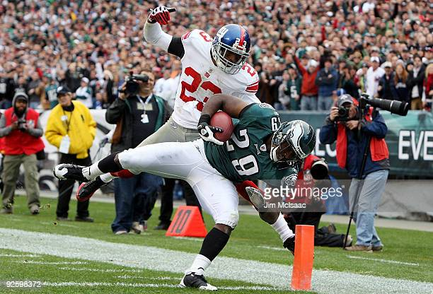 LeSean McCoy of the Philadelphia Eagles falls into the endzone ahead of Corey Webster of the New York Giants for a fourth quarter touchjdown on...