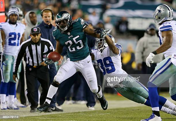 LeSean McCoy of the Philadelphia Eagles gets pushed out of bounds by Brandon Carr of the Dallas Cowboys at Lincoln Financial Field on December 14...
