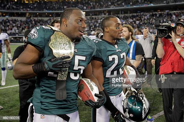 LeSean McCoy of the Philadelphia Eagles holds a championship belt as he and Brandon Boykin wait to be interviewed after a game against the Dallas...