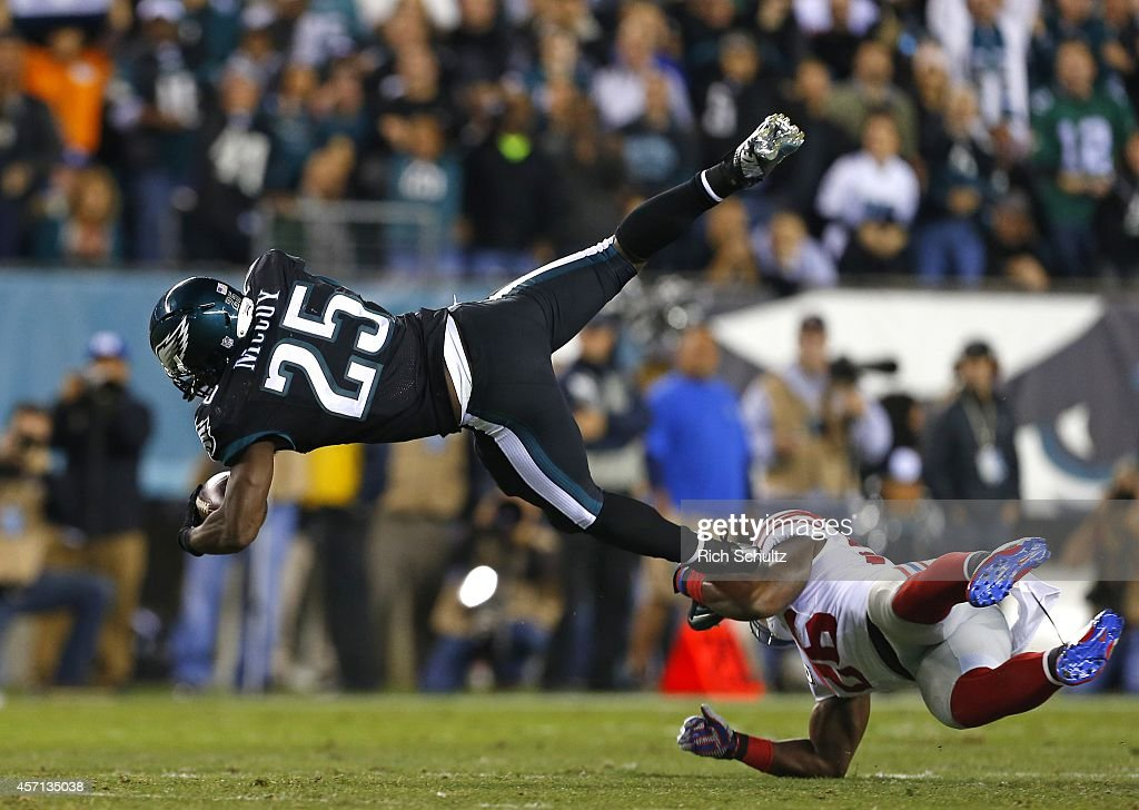 <a gi-track='captionPersonalityLinkClicked' href=/galleries/search?phrase=LeSean+McCoy&family=editorial&specificpeople=4484228 ng-click='$event.stopPropagation()'>LeSean McCoy</a> #25 of the Philadelphia Eagles is hit by <a gi-track='captionPersonalityLinkClicked' href=/galleries/search?phrase=Antrel+Rolle&family=editorial&specificpeople=775267 ng-click='$event.stopPropagation()'>Antrel Rolle</a> #26 of the New York Giants after running for a first down during the first quarter in a football game at Lincoln Financial Field on October 12, 2014 in Philadelphia, Pennsylvania.