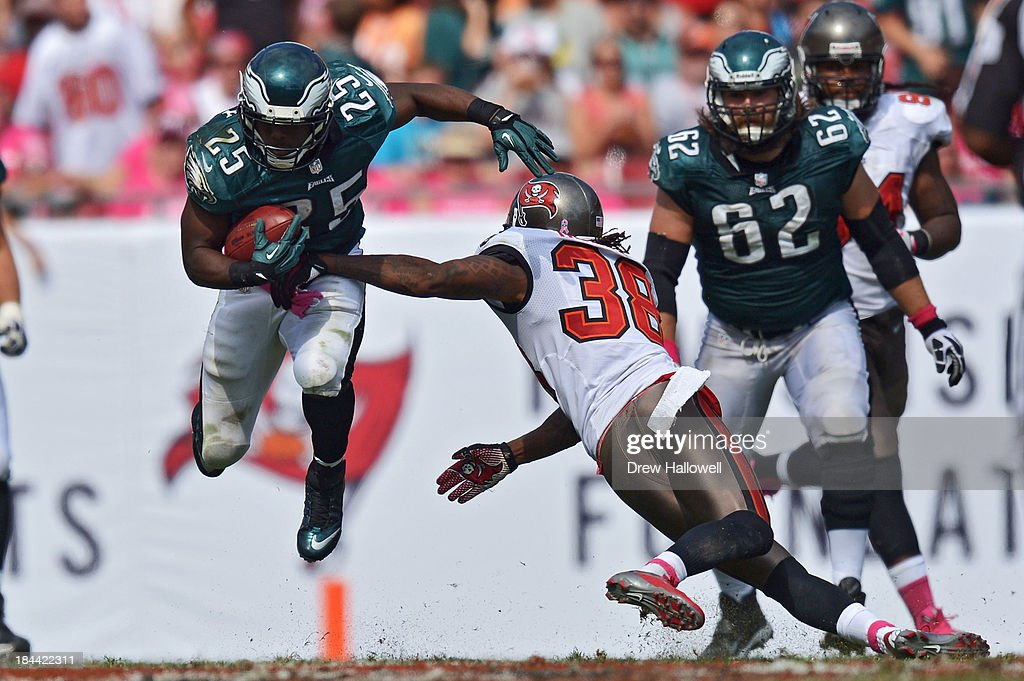 <a gi-track='captionPersonalityLinkClicked' href=/galleries/search?phrase=LeSean+McCoy&family=editorial&specificpeople=4484228 ng-click='$event.stopPropagation()'>LeSean McCoy</a> #25 of the Philadelphia Eagles jumps around <a gi-track='captionPersonalityLinkClicked' href=/galleries/search?phrase=Dashon+Goldson&family=editorial&specificpeople=2167242 ng-click='$event.stopPropagation()'>Dashon Goldson</a> #38 of the Tampa Bay Buccaneers at Raymond James Stadium on October 13, 2013 in Tampa, Florida. The Eagles won 30-21.