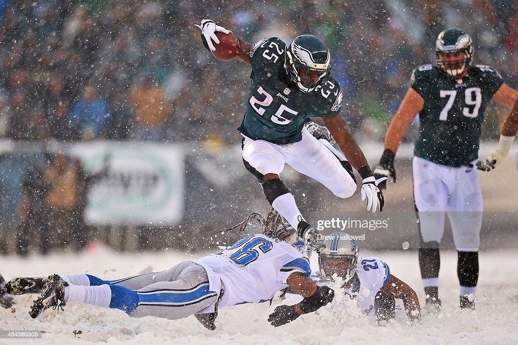 LeSean McCoy #25 of the Philadelphia Eagles jumps over Louis Delmas #26 of the Detroit Lions and runs for his first touchdown of the game at Lincoln Financial Field on December 8, 2013 in Philadelphia, Pennsylvania. The Eagles won 34-20.