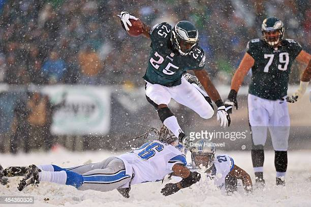 LeSean McCoy of the Philadelphia Eagles jumps over Louis Delmas of the Detroit Lions and runs for his first touchdown of the game at Lincoln...