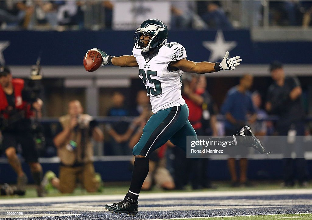 LeSean McCoy of the Philadelphia Eagles runs for a touchdown against the Dallas Cowboys in the second half at ATT Stadium on November 27 2014 in...