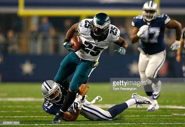 LeSean McCoy of the Philadelphia Eagles runs over CJ Spillman of the Dallas Cowboys on his way to a touchdown in the second half at ATT Stadium on...