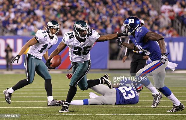 LeSean McCoy of the Philadelphia Eagles runs the ball against Kenny Phillips of the New York Giants in the first half at MetLife Stadium on November...