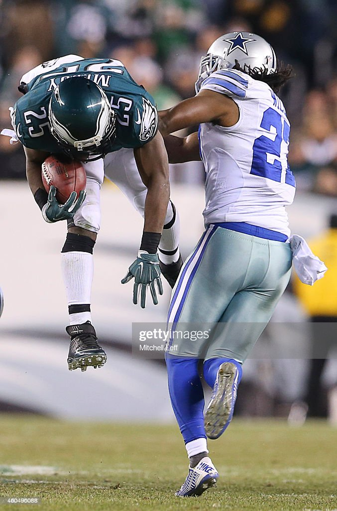 LeSean McCoy of the Philadelphia Eagles runs the ball and is tackled by JJ Wilcox of the Dallas Cowboys at Lincoln Financial Field on December 14...