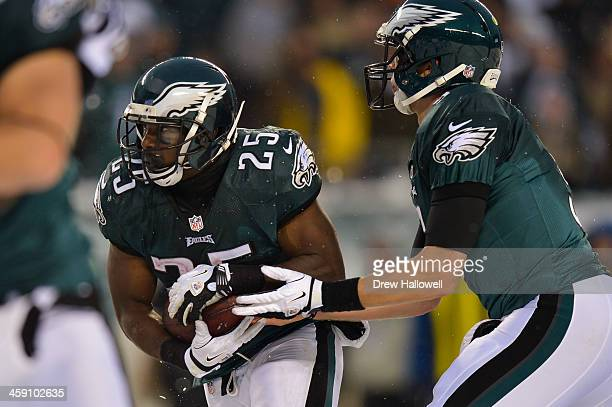LeSean McCoy of the Philadelphia Eagles takes a handoff from Nick Foles against the Detroit Lions at Lincoln Financial Field on December 8 2013 in...