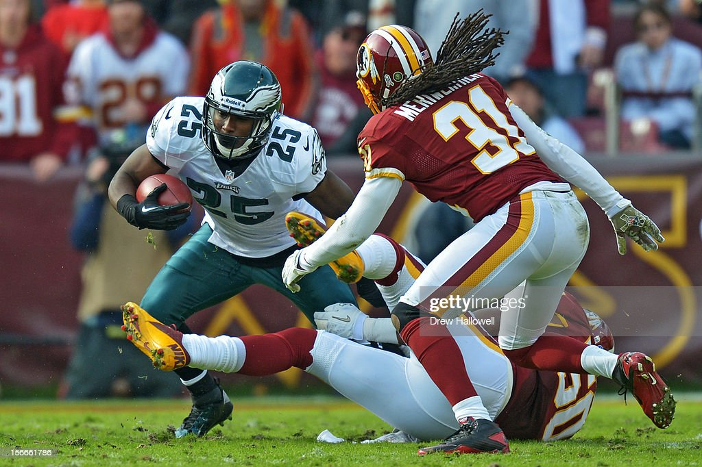 <a gi-track='captionPersonalityLinkClicked' href=/galleries/search?phrase=LeSean+McCoy&family=editorial&specificpeople=4484228 ng-click='$event.stopPropagation()'>LeSean McCoy</a> #25 of the Philadelphia Eagles tries to evade Rob Jackson #50 and <a gi-track='captionPersonalityLinkClicked' href=/galleries/search?phrase=Brandon+Meriweather&family=editorial&specificpeople=2109760 ng-click='$event.stopPropagation()'>Brandon Meriweather</a> #31 of the Washington Redskins at FedEx Field on November 18, 2012 in Landover, Maryland. The Redskins won 31-6.