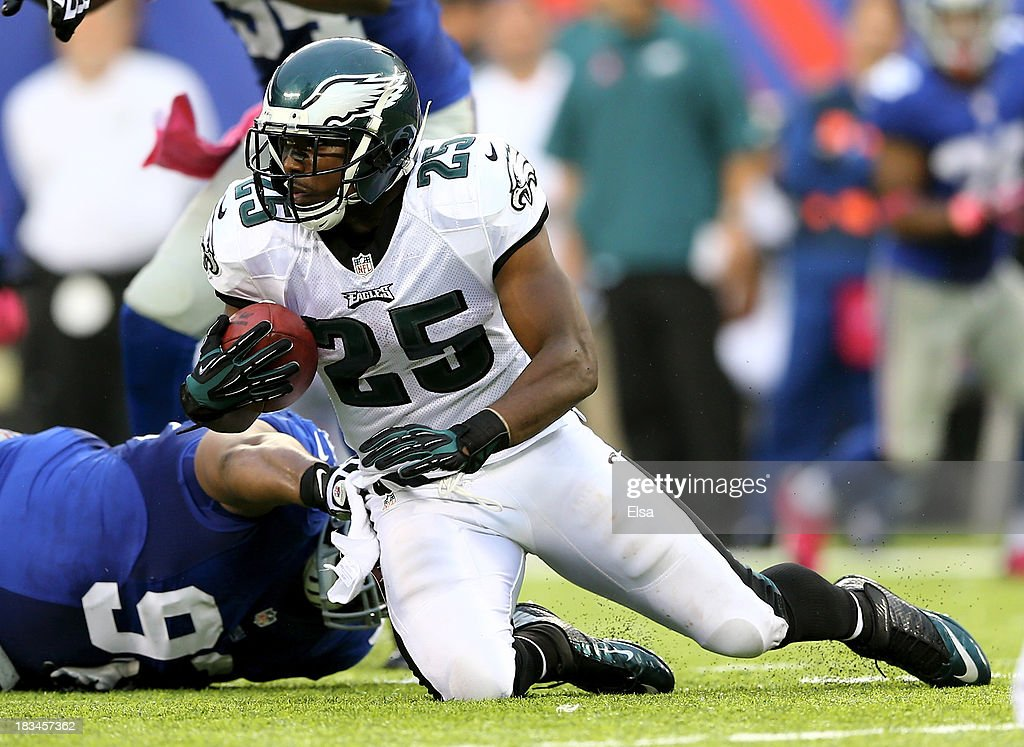 LeSean McCoy of the Philadelphia Eagles tries to get a few yards as Mike Patterson of the New York Giants defends at MetLife Stadium on October 6...