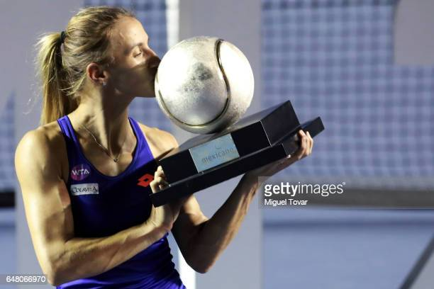 Lesia Tsurenko celebrates by kissing the champions trophy after winning the Final match between Lesia Tsurenko and Kristina Mladenovic as part of the...