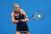 Lesia Tsurenko of the Ukraine plays a backhand in her first round match against Madison Keys of the United States during day two of the 2015...
