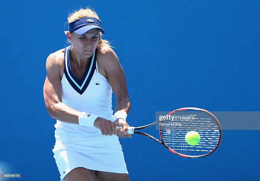 <a gi-track='captionPersonalityLinkClicked' href=/galleries/search?phrase=Lesia+Tsurenko&family=editorial&specificpeople=7654433 ng-click='$event.stopPropagation()'>Lesia Tsurenko</a> of the Ukraine plays a backhand in her first round match against Varvara Lepchenko of the United States during day two of the 2014 Australian Open at Melbourne Park on January 14, 2014 in Melbourne, Australia.