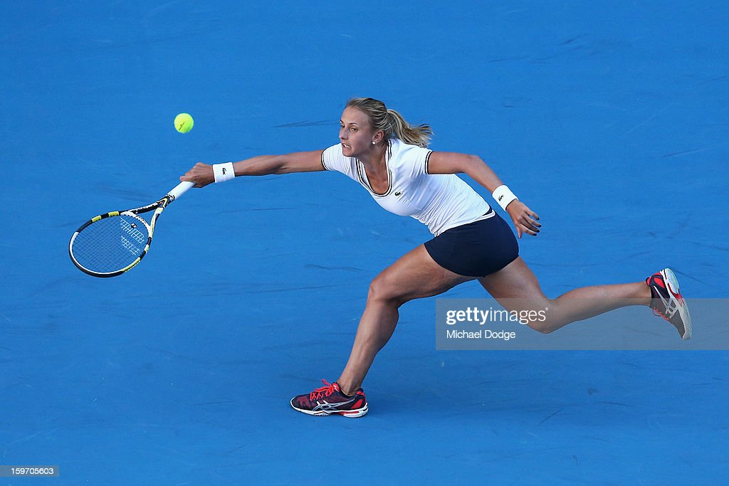 Lesia Tsurenko of the Ukraine plays a forehand in her third round match against Caroline Wozniacki of Denmark during day six of the 2013 Australian Open at Melbourne Park on January 19, 2013 in Melbourne, Australia.