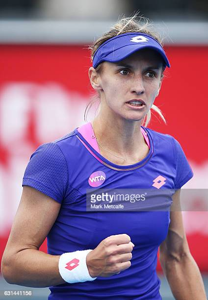 Lesia Tsurenko of Ukraine celebrates winning match point in her second round match against Johanna Larsson of Sweden during day two of the 2017...