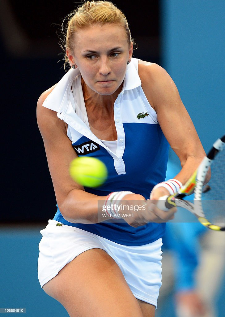 Lesia Tsurenko of Ukraine hits a backhand return in her victory over Jarmila Gajdosova of Australia in the second round at the Brisbane International tennis tournament on January 2, 2013. AFP PHOTO/William WEST USE