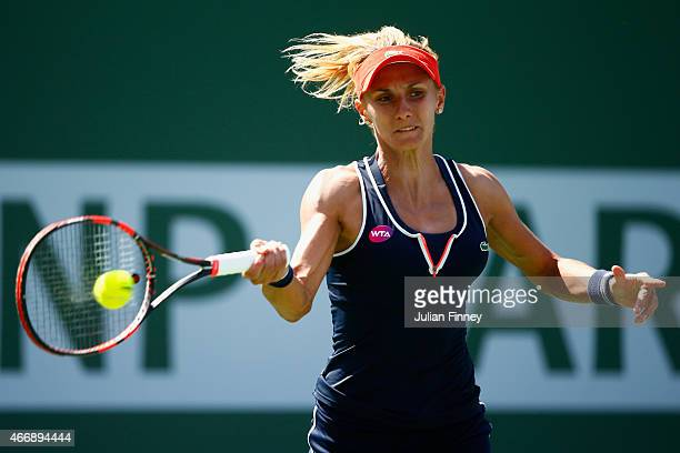 Lesia Tsurenko of Ukraine in action against Jelena Jankovic of Serbia during day eleven of the BNP Paribas Open tennis at the Indian Wells Tennis...