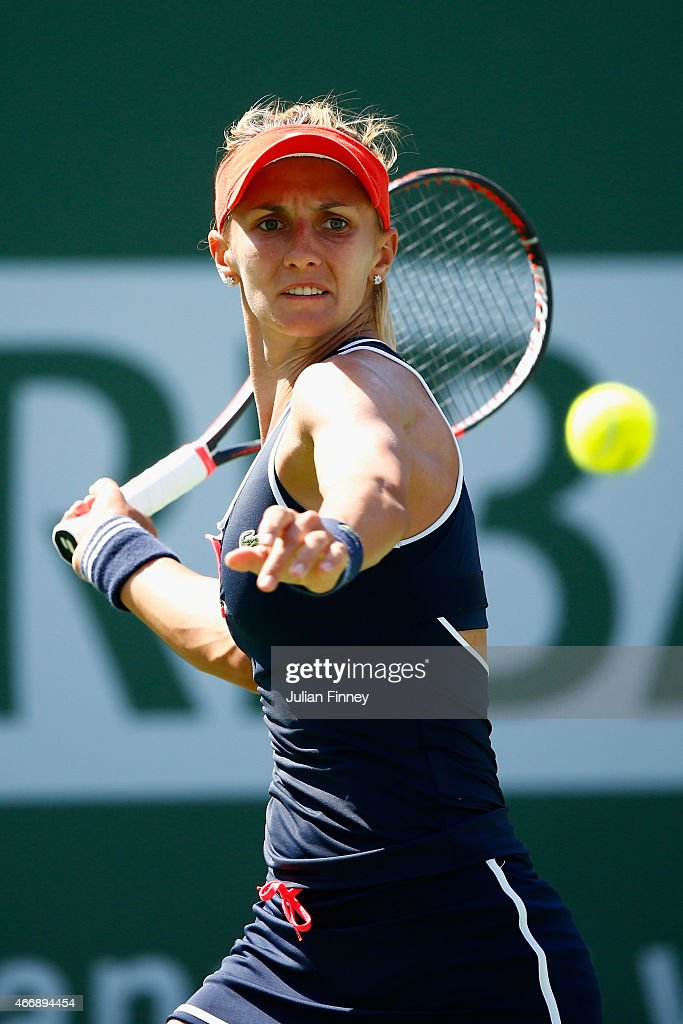 <a gi-track='captionPersonalityLinkClicked' href=/galleries/search?phrase=Lesia+Tsurenko&family=editorial&specificpeople=7654433 ng-click='$event.stopPropagation()'>Lesia Tsurenko</a> of Ukraine in action against Jelena Jankovic of Serbia during day eleven of the BNP Paribas Open tennis at the Indian Wells Tennis Garden on March 19, 2015 in Indian Wells, California.