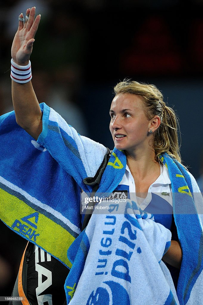 Lesia Tsurenko of Ukraine leaves the court after losing her match against Anastasia Pavlyuchenkova of Russia on day six of the Brisbane International at Pat Rafter Arena on January 4, 2013 in Brisbane, Australia.