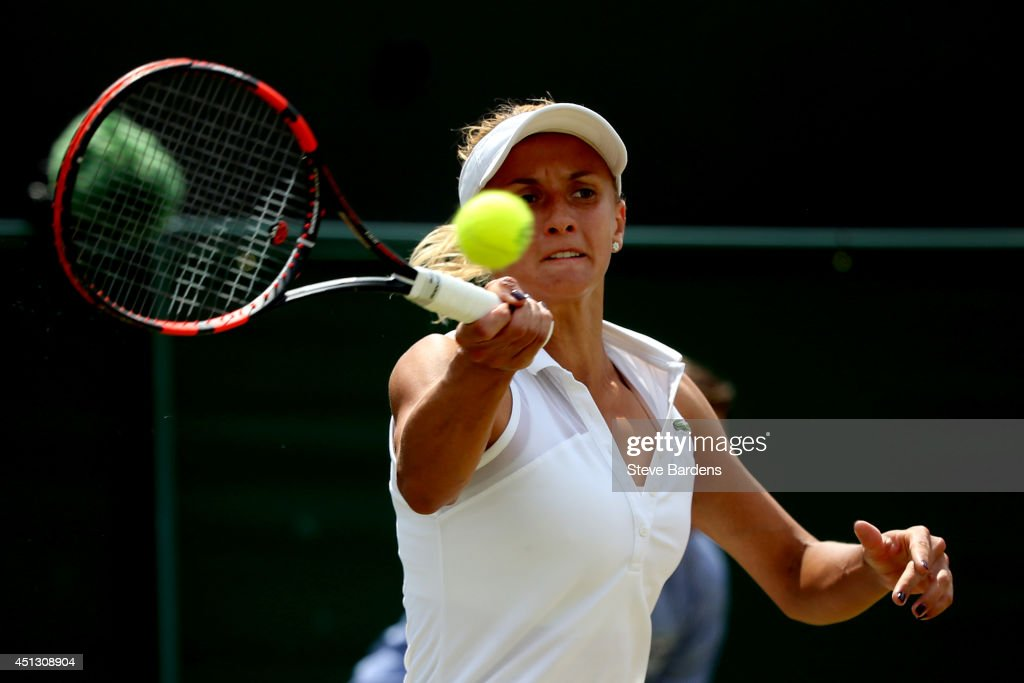 Lesia Tsurenko of Ukraine plays a forehand return during the Ladies' Singles second round match against Simona Halep of Romania on day five of the...