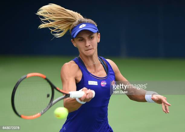 Lesia Tsurenko of Ukraine plays forehand against Shuai Peng of China during day two of the WTA Dubai Duty Free Tennis Championship at the Dubai...