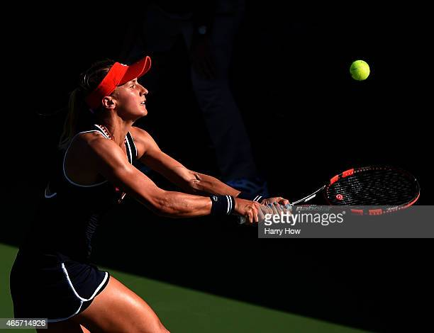Lesia Tsurenko of Ukraine reaches to hit a lob against Mayo Hibi of Japan during qualifying of the BNP Paribas Open tennis at the Indian Wells Tennis...