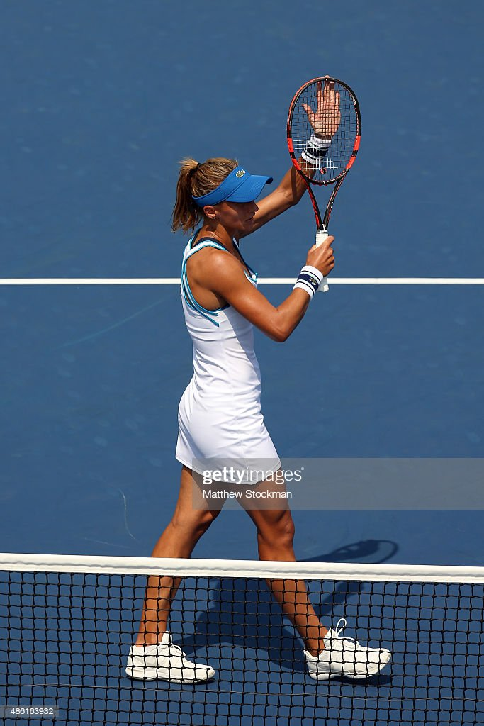 Lesia Tsurenko of Ukraine reacts after defeating Lucie Safarova of Czech Republic during their Women's Singles First Round match on Day Two of the...