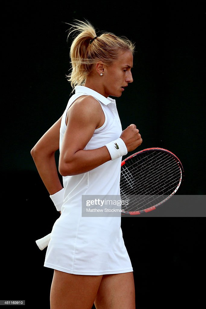 <a gi-track='captionPersonalityLinkClicked' href=/galleries/search?phrase=Lesia+Tsurenko&family=editorial&specificpeople=7654433 ng-click='$event.stopPropagation()'>Lesia Tsurenko</a> of Ukraine reacts during her Ladies' Singles first round match against Dinah Pfizenmaier of Germany on day two of the Wimbledon Lawn Tennis Championships at the All England Lawn Tennis and Croquet Club at Wimbledon on June 24, 2014 in London, England.