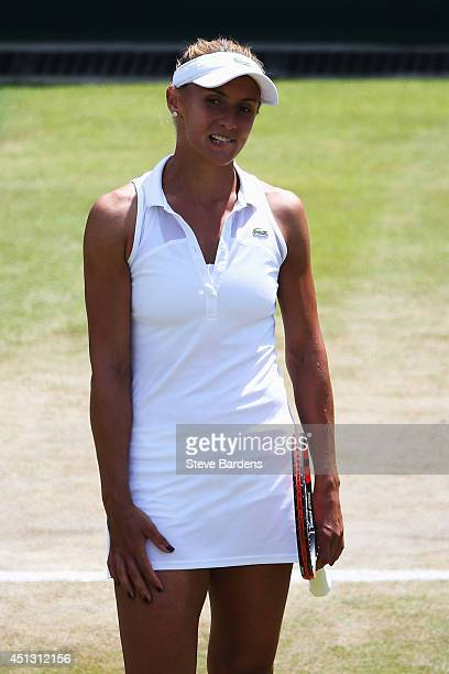 Lesia Tsurenko of Ukraine reacts during the Ladies' Singles second round match against Simona Halep of Romania on day five of the Wimbledon Lawn...