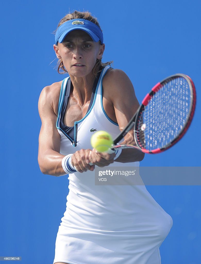 Lesia Tsurenko of Ukraine returns a shot against Coco Vandeweghe of the United States during a match in the first round of 2015 Wuhan Open at Optics...