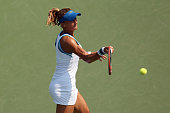 Lesia Tsurenko of Ukraine returns a shot against Lucie Safarova of Czech Republic during their Women's Singles First Round match on Day Two of the...