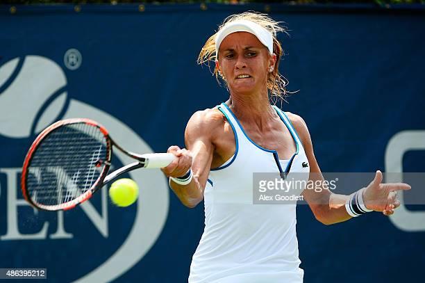 Lesia Tsurenko of Ukraine returns a shot against Varvara Lepchenko of the United States during their Women's Singles Second Round match on Day Four...