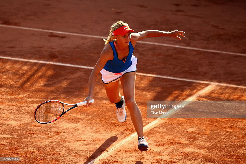 Lesia Tsurenko of Ukraine returns a shot next to her partner Aleksandra Krunic of Serbia during their women's doubles match against Anabel Medina...