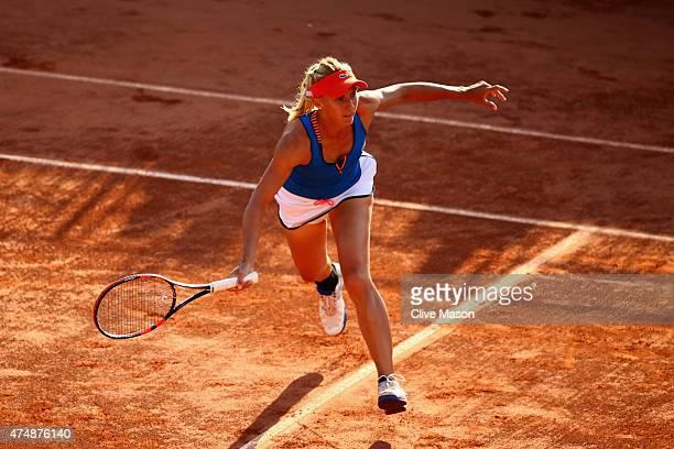 Lesia Tsurenko of Ukraine returns a shot next to her partner Aleksandra Krunic of Serbia during their women's doubles match against Anabel Medina...