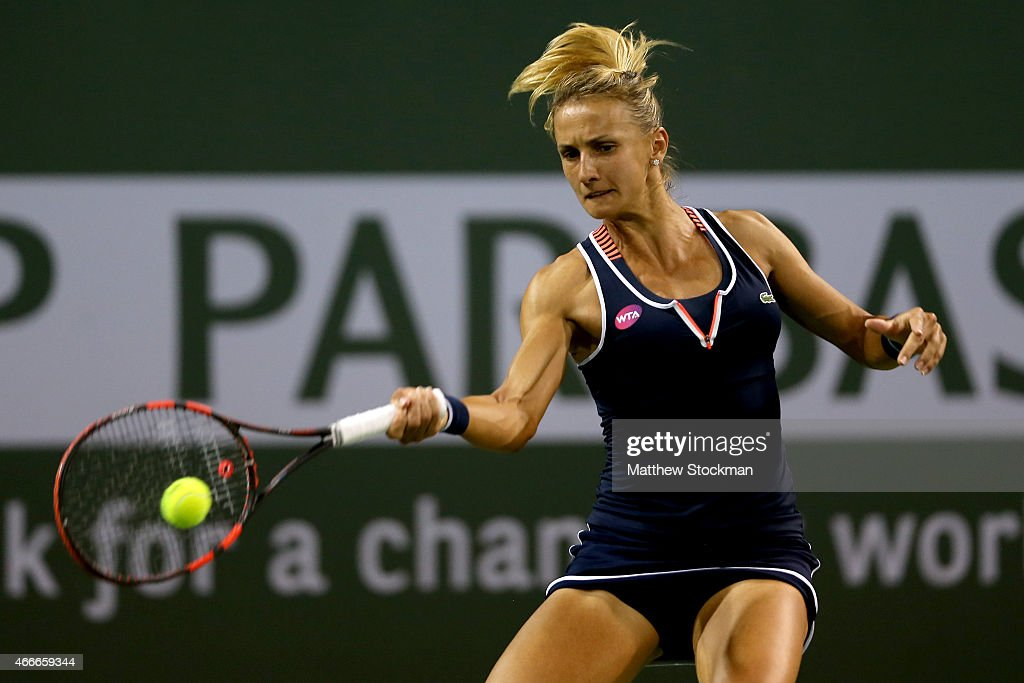 Lesia Tsurenko of Ukraine returns a shot to Eugenie Bouchard of Canada during day nine of the BNP Paribas Open at the Indian Wells Tennis Garden on March 17, 2015 in Indian Wells, California.