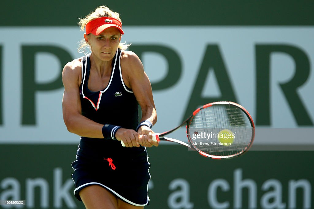 Lesia Tsurenko of Ukraine returns a shot to Jelena Jankovic of Serbia during day eleven of the BNP Paribas Open at the Indian Wells Tennis Garden on...