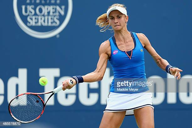 Lesia Tsurenko of Ukraine returns a shot to Lucie Safarova of Czech Republic during the semifinal round of the Connecticut Open at Connecticut Tennis...