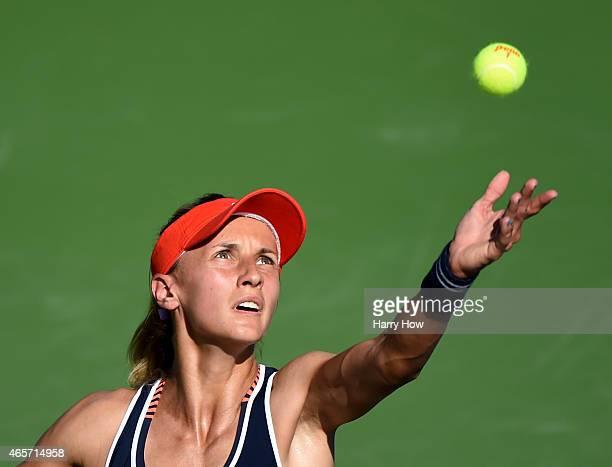 Lesia Tsurenko of Ukraine serves against Mayo Hibi of Japan during qualifying of the BNP Paribas Open tennis at the Indian Wells Tennis Garden on...