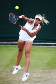 Lesia Tsurenko of Ukraine serves during the Ladies' Singles second round match against Simona Halep of Romania on day five of the Wimbledon Lawn...