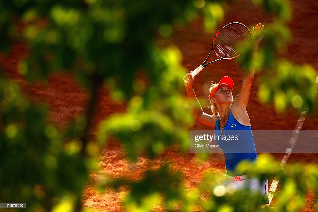 Lesia Tsurenko of Ukraine serves next to her partner Aleksandra Krunic of Serbia during their women's doubles match against Anabel Medina Garrigues...