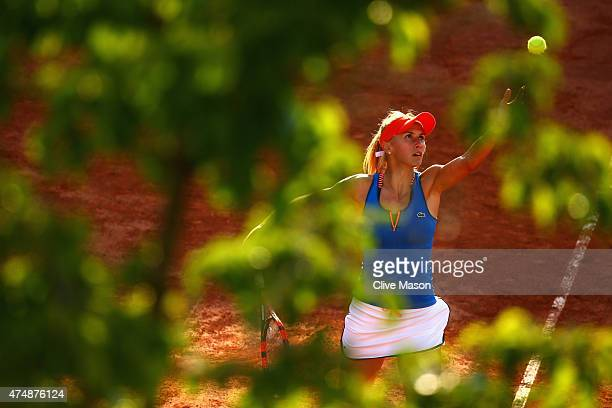 Lesia Tsurenko of Ukraine serves next to her partner Aleksandra Krunic of Serbia during their women's doubles match against Anabel Medina Garrigues...