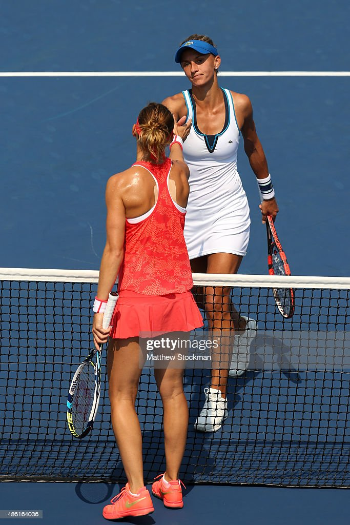 Lesia Tsurenko of Ukraine shakes hands with Lucie Safarova of Czech Republic after defeating her during their Women's Singles First Round match on...