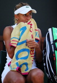 Lesia Tsurenko of Ukraine sits dejected during the Ladies' Singles second round match against Simona Halep of Romania on day five of the Wimbledon...